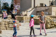 Children and soap bubbles. Lublin. Poland 2018 - April 14. Old Town, children are played with big soap bubbles stock photo