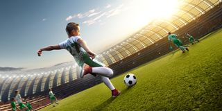 Children soccer player in action. In stadium royalty free stock image