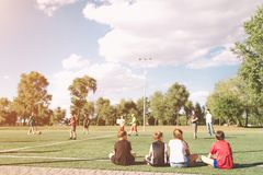 Children Soccer Team Playing Match. Football Game for Kids. Young Soccer Players Sitting on Pitch. Little Kids in Blue stock image