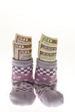 Children socks with dollar bills Stock Photography