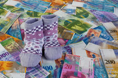 Children socks with Swiss Franc notes Royalty Free Stock Image