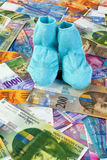 Children socks with Swiss Franc notes Stock Images