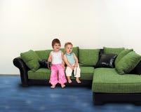 Children on sofa collage stock image