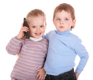 Children speaking  by phone. Royalty Free Stock Images