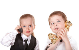 Children speaking by telephone. Royalty Free Stock Photos