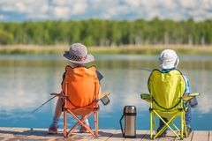 Children spend a weekend fishing. On the lake Stock Photography