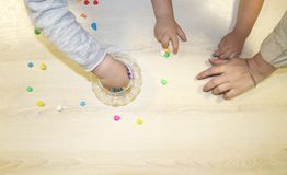 Kids group making arts and crafts in kindergarten. Children spending time in day care centre with the great interest. Children spending time in day care centre royalty free stock image