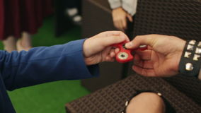 Children spin the spinner with your fingers stock video footage