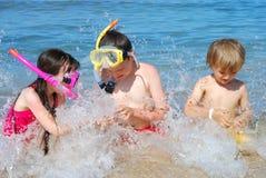 Children splashing in water royalty free stock image