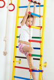 Children sports. 7 years old child playing on sports equipment stock image