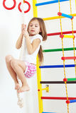 Children sports. 7 years old child playing on sports equipment stock photos