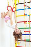Children sports. 7 years old child playing on sports equipment royalty free stock photography