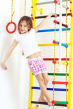 Children sports. 7 years old child playing on sports equipment stock photo