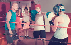 Children sportsmans at boxing workout with coach Stock Images