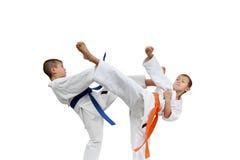 Children sportsmen are beating blows legs. Sportsmen are beating blows legs Royalty Free Stock Photography