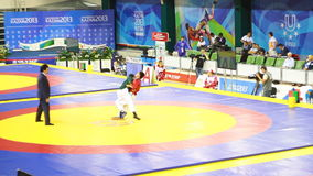 Children Sportsmen Fight Tense Short on Bright Indoor Arena. KAZAN, TATARSTAN/RUSSIA - MAY 15 2013: Children sportsmen fight tense short on bright round indoor stock footage