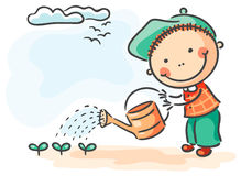 Children spring activities: boy watering sprouts Royalty Free Stock Photography