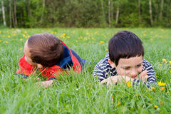 Children  in spring nature Stock Photos