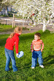 Children in spring park Royalty Free Stock Photo