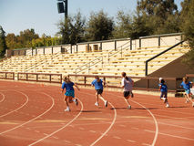 Children Sprinting. Young Children Sprinting on Track Stock Image