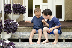 Children on stairs at home Stock Image