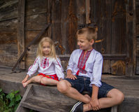 Children on the stairs. Little ukrainian children are playing on the stairs of old wooden house royalty free stock photos