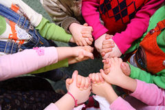 Children stand having joined hands, top view stock images