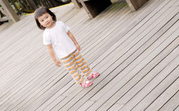 Children stand on the wood ground royalty free stock photography