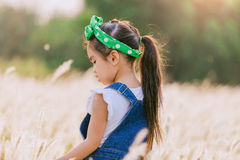 Children standing alone at the field during beautiful sunset stock photo