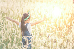 Children standing alone at the field during beautiful sunset. Children standing alone at the field during beautiful sunset royalty free stock image