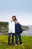 Children standing at Atlantic coast in Newfoundlan stock photography