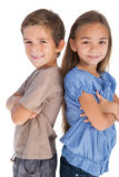 Children standing back to back with their arms crossed Royalty Free Stock Image