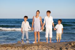 Children are standing on beach Stock Photography