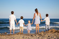 Children are standing on beach Royalty Free Stock Photo