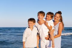 Children are standing on beach Royalty Free Stock Photography