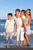 Children are standing on beach Stock Images
