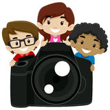 Children Standing behind a Big Digital Camera Royalty Free Stock Image