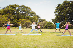 Children standing and doing yoga Stock Images