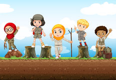 Children standing on logs Royalty Free Stock Photos