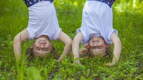 Children standing in a meadow on the hands Stock Photos