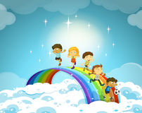 Children standing over the rainbow Royalty Free Stock Photo