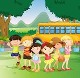 Children standing by the schoolbus Royalty Free Stock Photos