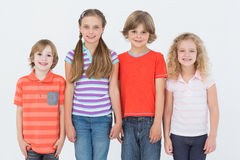 Children standing side by side on white background Royalty Free Stock Photo