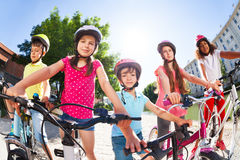 Children standing together with bicycles in summer Royalty Free Stock Image