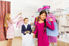 Children standing together in the clothing store Royalty Free Stock Photo