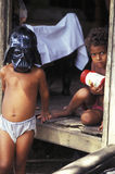 Children with Star Wars mask in Amazonia. Children in Amazonia, Brazil. One of the kids is wearing the mask of a Jedi from the film Star Wars Royalty Free Stock Images