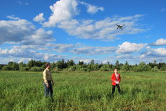 Children start the quadcopter. In the field for shooting of the district Stock Photo