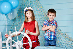 Children with steering wheel on voyage Stock Photos