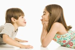 Children sticking out tongues. Stock Images