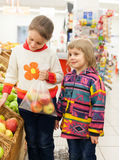 Children in   store  with products. Stock Photo